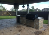 Bodington Outdoor Kitchen and stamped concrete