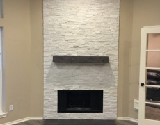 stacked stone fireplace and mantel