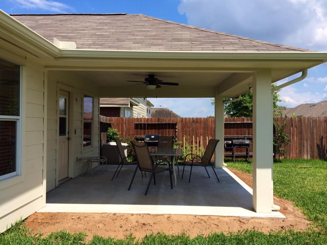 Imbrogno hip roof patio cover houston texas for Cost to build a house in texas