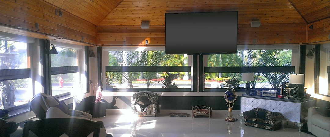 Motorized retractable screens in houston for Automatic retractable screens