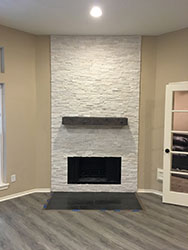 stacked-stone-fireplace-and-mantel